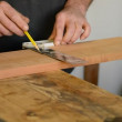 Craftsmor carpenter mark out in table wood — Stock Video #25900317