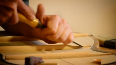 Luthier manufacturing a clasical guitar — Stock Video