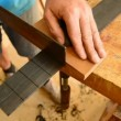 Luthier making the frets of a guitar with a hacksaw — Stock Video