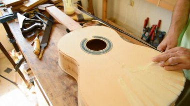 Luthier manufacturing a guitar — Stock Video