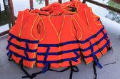 Orange life jackets — Stock Photo