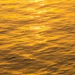 Stock Photo: Waves of golden water.