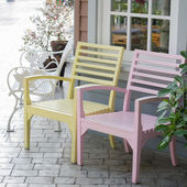 Pink and yellow wooden chairs — Stok fotoğraf