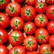 Background of natural tomatoes close-up view — Stock Photo