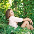 Stockfoto: Beautiful young womrelaxing in garden