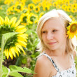 Dreamy cute young girl in the field of sunflowers — Stock Photo