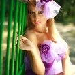 Close-up portrait glamorous young blonde girl,posing in violet dress — Stock Photo