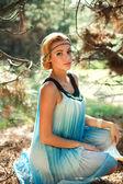 Portrait of beautiful girl in pine wood — Stock Photo