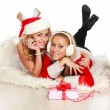 Two beautyful girls at Christmas time at studio on white — Stock Photo