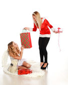 Two cute girls congratulate each other gifts, in the studio on a white — Stock Photo