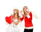 Two beautiful Christmas girl with a red toy heart,isolated on white,Valentine's Day and Christmas concept — Stock Photo