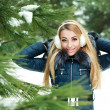 Portrait of beautiful smiling girl in snowy winter forest — Stock Photo
