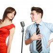 Young guy singing to a pretty girl, studio, isolated on white — Stock Photo #21692493