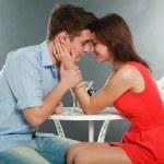 Happy young couple having romantic dinner indoors, in studio — Stock Photo #22456385
