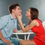 Happy young couple having romantic dinner indoors, in studio — Stock Photo #22456399