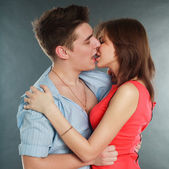 Close-up young couple In love, on grey background, in studio — Stock Photo