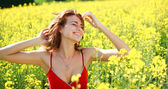 Dreamy girl enjoying the nature on a sunny day in the flowering — Stock Photo