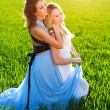 Two girlfriends in long dresses, together outdoors — Stock Photo