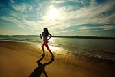 Young slim woman on water at river coast, fitness and heath care — Stock Photo