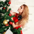Pretty woman with christmas tree — Stock Photo #36138575