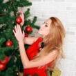 Pretty woman with christmas tree — Stock fotografie