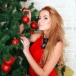 Pretty woman with christmas tree — Stock Photo #36138629