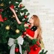 Pretty woman with christmas tree — ストック写真