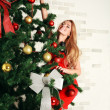 Pretty woman with christmas tree — Stock Photo #36138965