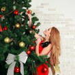 Stock Photo: Pretty womwith christmas tree