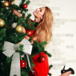 Pretty woman with christmas tree — Stok fotoğraf