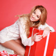 Happy sensual woman with christmas gifts, studio on pink — Foto Stock