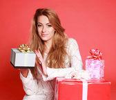 Beautiful sensual woman with christmas gifts, studio on pink — Stock Photo