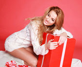 Happy sensual woman with christmas gifts, studio on pink — Stok fotoğraf
