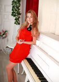 The attractive young woman in a red dress — Stock Photo