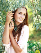 Young woman enjoying summer day in the garden trees — Stock Photo