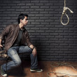 Dramatic lighting photo of young adult considering suicide with a hangman's - Stok fotoğraf