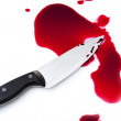 Bloody knife with blood splatter - Stock Photo