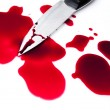 Bloody knife with blood splatter — Stock Photo #12283174