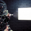 Old film projector with dramatic lighting — Stock Photo #12283218