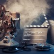 Old film projector and movie objects - Stock Photo