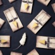 Stock Photo: Multiple mouse traps with cheese on a dark background