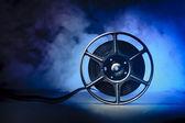 Movie spool with film — Stockfoto