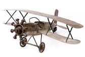 Old airplane toy on white — Stock Photo