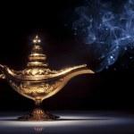 Magic Aladdin's Genie lamp on black with smoke — Stock Photo