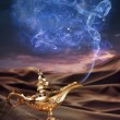 Magic Aladdin's Genie lamp on a desert — Stock Photo