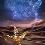 Magic Aladdin's Genie lamp on a desert — Stock Photo