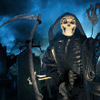Grim reaper, angel of death with lamp at night - Stock Photo