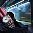 Time bomb inside a backpack in a subway station - Stock Photo