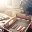 Dramatic lighting image of an old, vintage workspace - Stock Photo