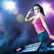Stock Photo: Beautiful DJ girl at the club